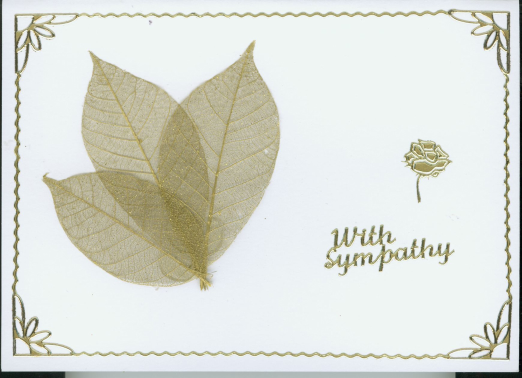 gold sympathy card with a gold leaf