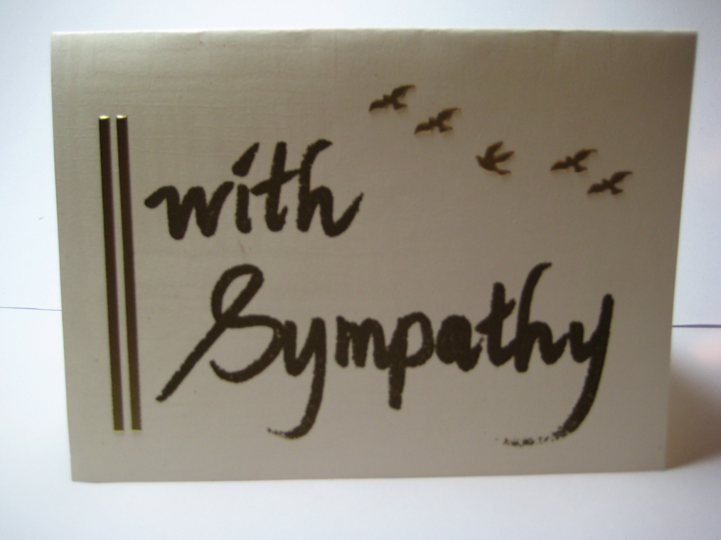 gold sympathy card with calligraphy and stickers of gold birds flying